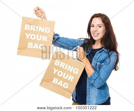 Shopping woman hold with shopping bag and showing phrase bring your bag