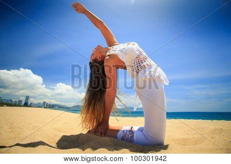 Blonde Girl In Lace In Yoga Asana Wheel Back Bend On Beach