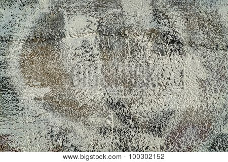 closeup of aging, grunge concrete wall texture with beige paint, cracks and chips