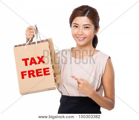 Asian woman finger point to shopping bag and showing phrase of tax free