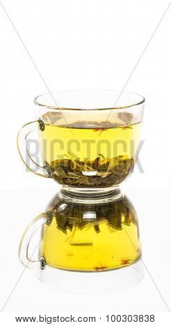 Transparent cup of tea with reflection.