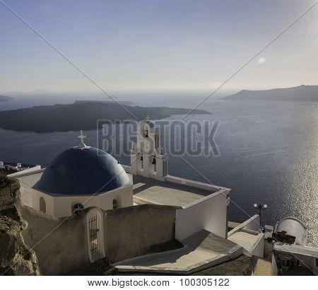 Sunset over blue roofed churches, Santorini