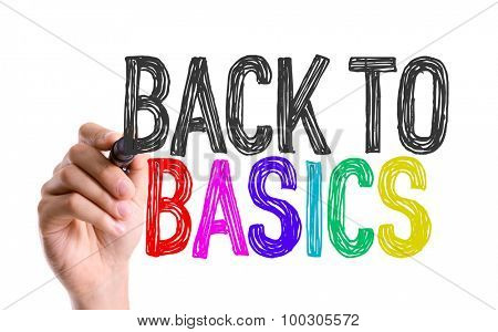 Hand with marker writing the word Back to Basics