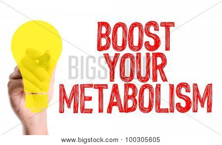 Hand with marker writing the word Boost Your Metabolism