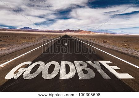 Goodbye written on desert road
