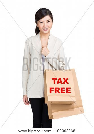 Young woman holding shopping bag and showing tax free
