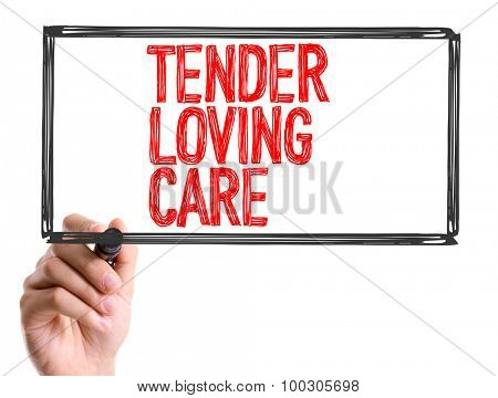 Hand with marker writing the word Tender Loving Care