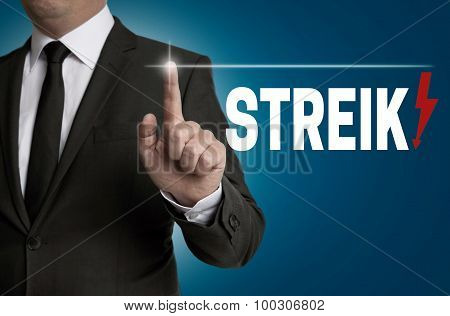Streik Touchscreen Is Operated By Businessman Concept