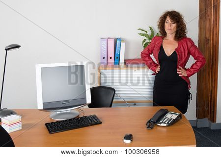 Woman At Work  Happy And Looking At The Camera