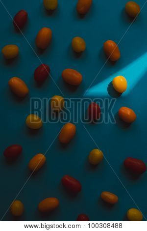 Cherry Tomatoes Of Different Color Over Blue Background.