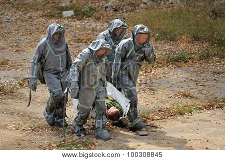 Orel, Russia - August 28, 2015: Russian Emergency Control Rescue Team Carrying Injuired Man