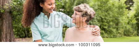 Afroamerican Caregiver Supporting Elderly Woman