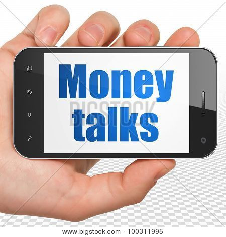 Finance concept: Hand Holding Smartphone with Money Talks on display