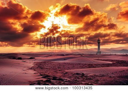 a view of the lighthouse at El Fangar, in the Ebro Delta, in Spain, in a cloudy day