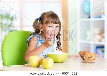 Kid eating Healthy Food in Nursery