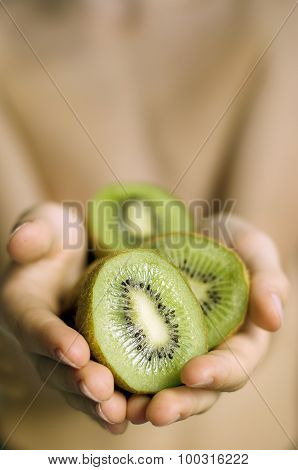 Sliced Kiwi in the boy handle