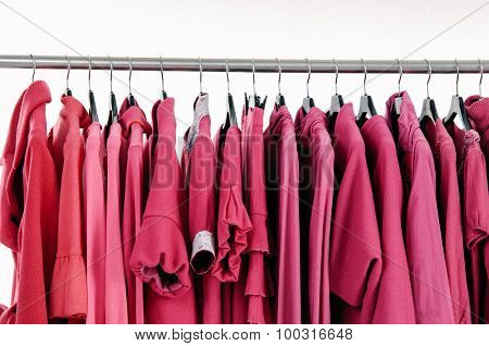 Variety of female red clothing and sundress on hanging