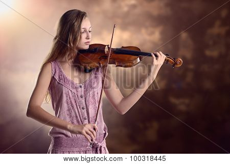 Pretty Young Violinist Playing The Violin
