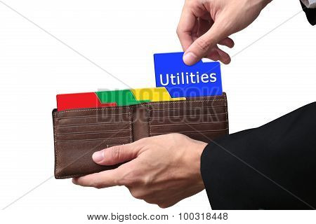 Businessman Hands Pulling Folder Utilities Concept On Brown Wallet.