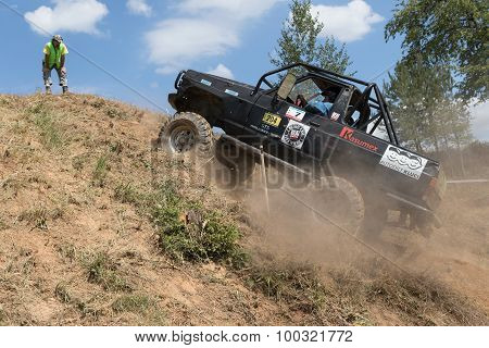 Black Off Road Car Leaves A Steep Hill