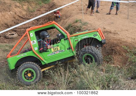 Side View Of A Green Small Off Road Car In Terrain