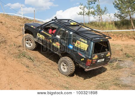 Big Black Off Road Car Is Overcoming A Steep Slope