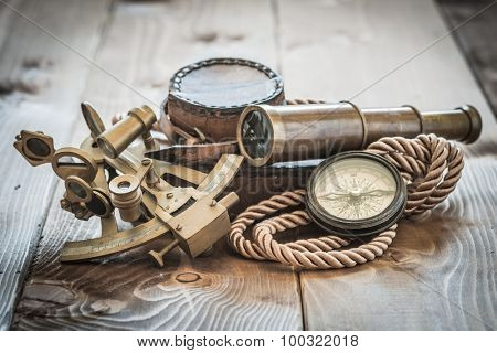 vintage still life with compass,sextant and spyglass