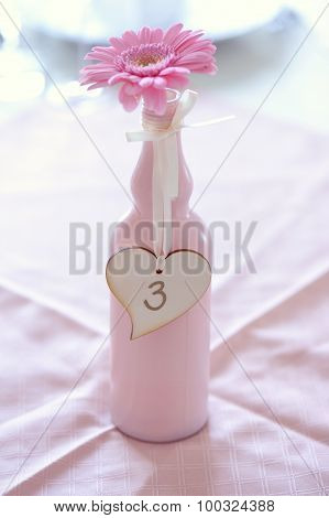 Beautiful Bouquet In Bottle With Table Number