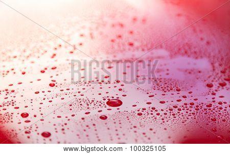 Drops of water on red  floor