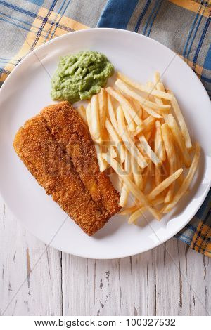 English Food: Fried Fish In Batter With Chips Close-up. Vertical Top View