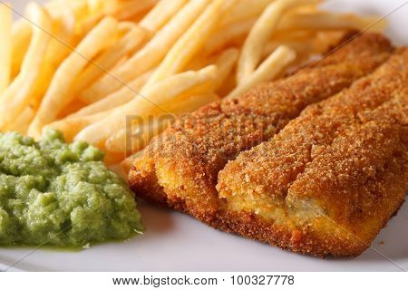 Fried Fish Fillets And Chips And Pea Puree Macro. Horizontal