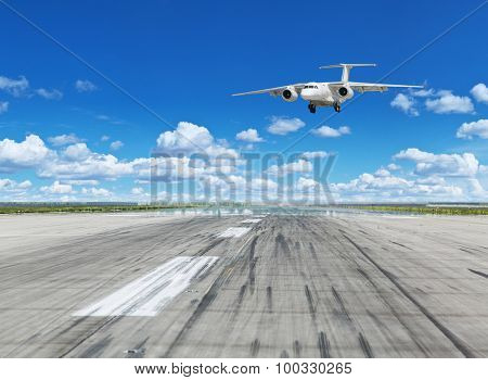 Airplane landing on runaway in the airport.