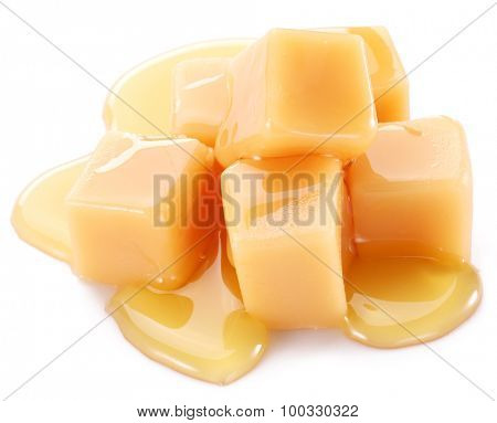 Sweet caramel candies on the white background.