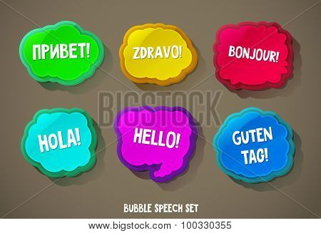 Abstract glossy speech bubbles with the word hello in different languages.