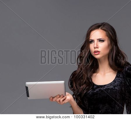 Sad woman using a tablet