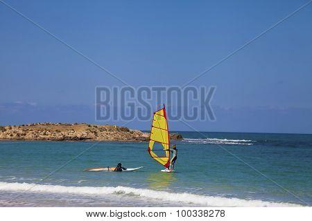 Novice Windsurfers Near Shore
