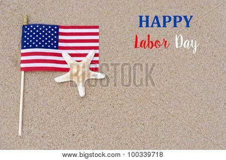 Happy Labor Day Background With Flag, Starfish On The Sandy Beach