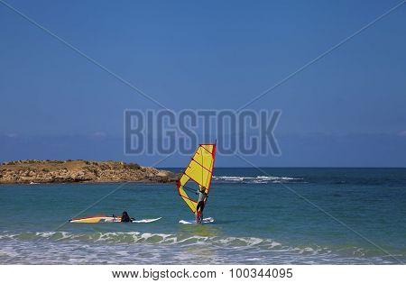 Female Windsurfers In The Sea