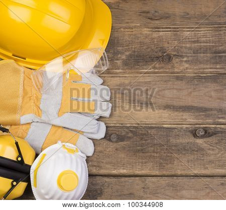 Safety equipment on wooden background with copy space