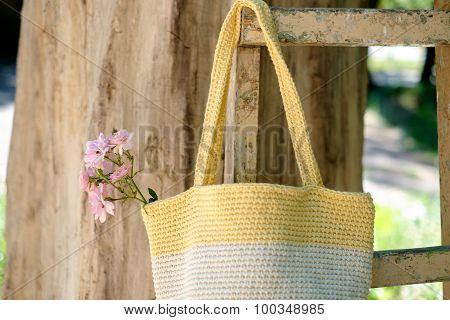 Knitted Crochet Bag On The Background Of Nature