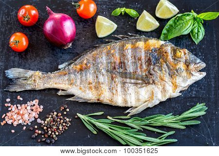 Grilled Dorada Fish With Fresh Vegetables And Herbs