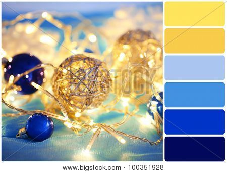 Christmas ornaments and garland and palette of colors