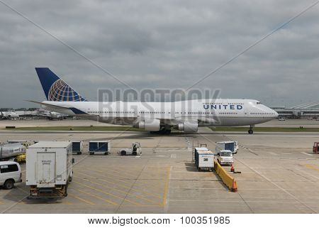 CHICAGO, ILLINOIS - AUGUST 30, 2015: A United Airlines Boeing 747-422 rolling down the taxiway at O'Hare Airport during it's regular passenger flight. United Airlines is headquartered in Chicago.