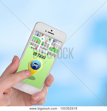 Hands holding mobile smart phone with interface taxi on blue background