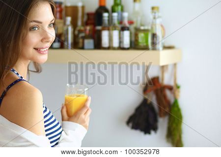 Portrait of a pretty woman holding glass with tasty juice