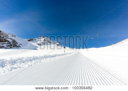 Newly Groomed Ski Slope On A Sunny Day