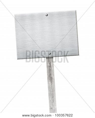 Aluminum metal plate nailed on wooden gray pole or banner