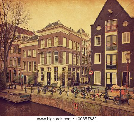 Amsterdam canal, Photo in retro style. Paper texture.