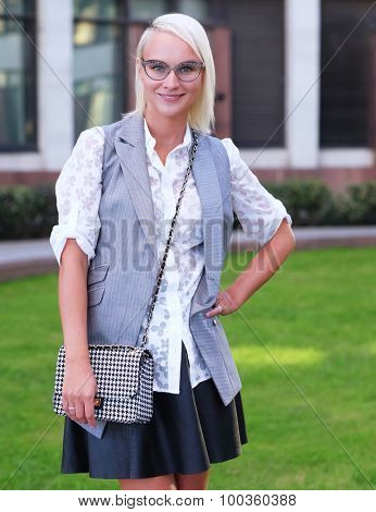 Beautiful stylish young woman wearing glasses  on a street