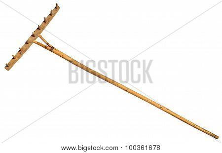 Garden rake isolated on white.  Vintage Retro Wooden Rake Handmade